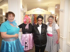 Staff dressed up at the Elvis Rock and Roll Night