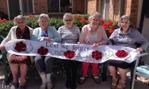 Remembrance Day Knitting Poppy Flowers at Homestyle Aged Care